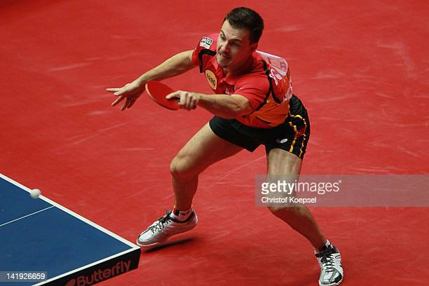 Timo Boll of Germany plays a forehand during s his match against Yang Zi of Singapore during the LIEBHERR table tennis team world cup 2012...