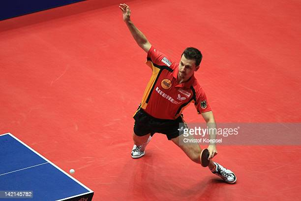 Timo Boll of Germany plays a forehand during the match against Jens Lundqvist of Sweden during the LIEBHERR table tennis team world cup 2012...