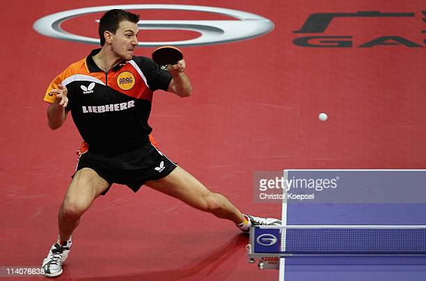 Timo Boll of Germany plays a forehand during the second round Men's Single match between Boll of Germany and Yang Zi of Singapore during the World...