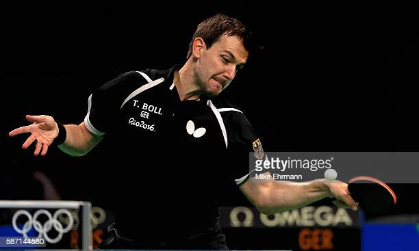 Timo Boll of Germany plays a Men's Singles third round match against Alexander Shibaev of Russia on Day 2 of the Rio 2016 Olympic Games at Riocentro...