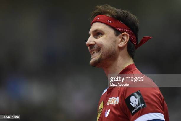 Timo Boll of Germany reacts against Yuta Tanaka of Japan during the men's singles round one match on day one of the ITTF World Tour LION Japan Open...