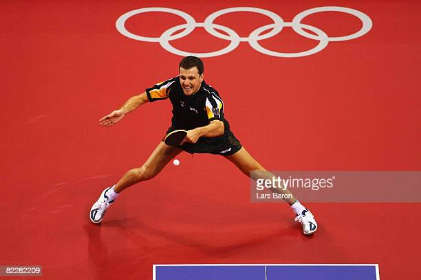 Timo Boll of Germany returns to Zoran Primorac of Croatia in the men's team table tennis event at the Peking University Gymnasium during Day 5 of the...