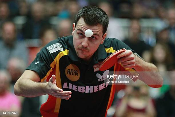 Timo Boll of Germany serves during his match against Dmitrij Prokopcov of Czech Republic during the LIEBHERR table tennis team world cup 2012...