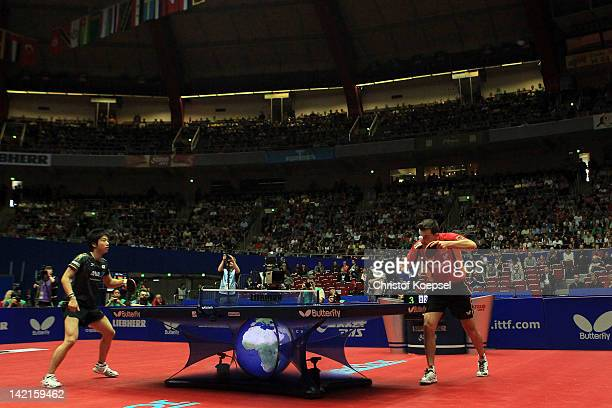 Timo Boll of Germany serves during his match against Jun Mizutani of Japan during the LIEBHERR table tennis team world cup 2012 championship division...