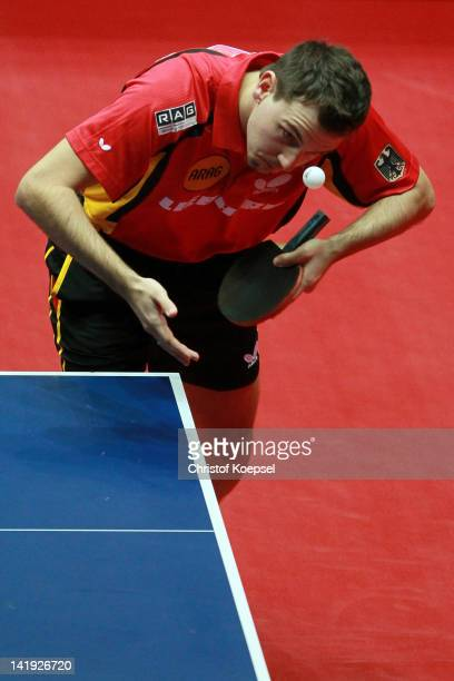 Timo Boll of Germany serves during his match against Yang Zi of Singapore during the LIEBHERR table tennis team world cup 2012 championship division...