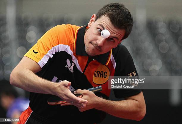 Timo Boll of Germany serves during the second round Men's Single match between Boll of Germany and Yang Zi of Singapore during the World Table Tennis...
