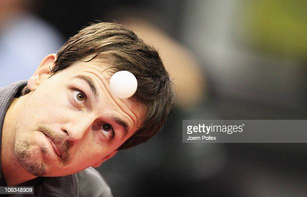 Timo Boll of Germany serves to Ning Gao of Singapore during their Table Tennis World Cup 2010 match at the Boerdeland Hall on October 29, 2010 in...