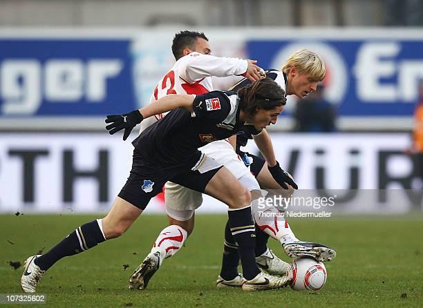 Timo Gebhardt of Stuttgart fights for the ball with Sebastian Rudy and Alexander Beck of Hoffenheim during the Bundesliga match between VfB Stuttgart...