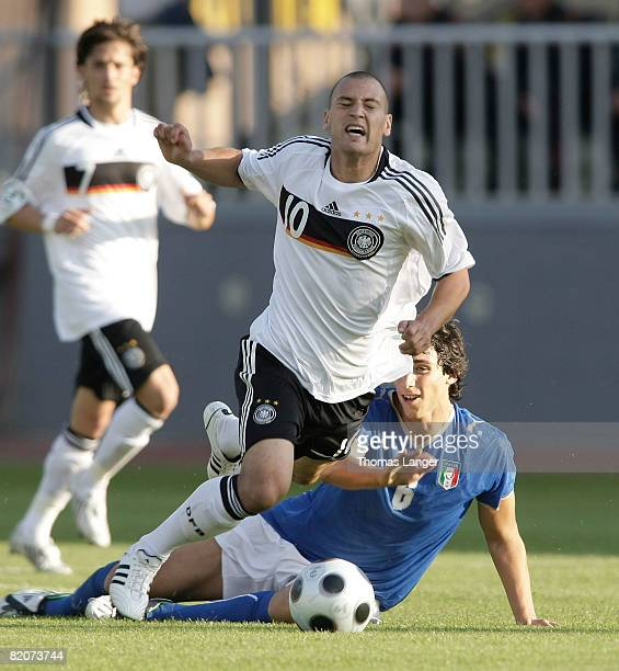 Timo Gebhart of Germany and Matteo Gentili of Italy battle for the ball l during the U19 European Championship final match between Germany and Italy...