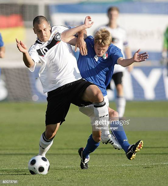 Timo Gebhart of Germany and Silvano Raggioo Garibaldi of Italy battle for the ball l during the U19 European Championship final match between Germany...