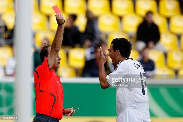 Timo Gebhart of Germany reacts as he is sent off by referee Goran Spirkoski during the UEFA U21 Championship qualifying match between Germany and San...