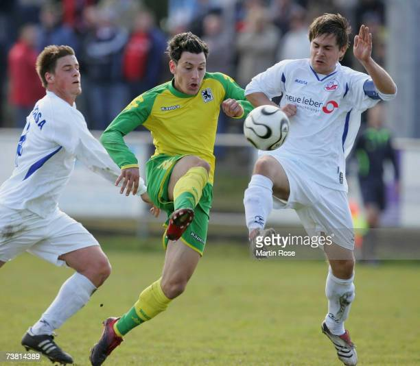 Timo Gebhart of Munich and Tom Kruse of Rostock fight for the ball during the DFB Juniors German Cup between Hansa Rostock and 1860 Munich at the...