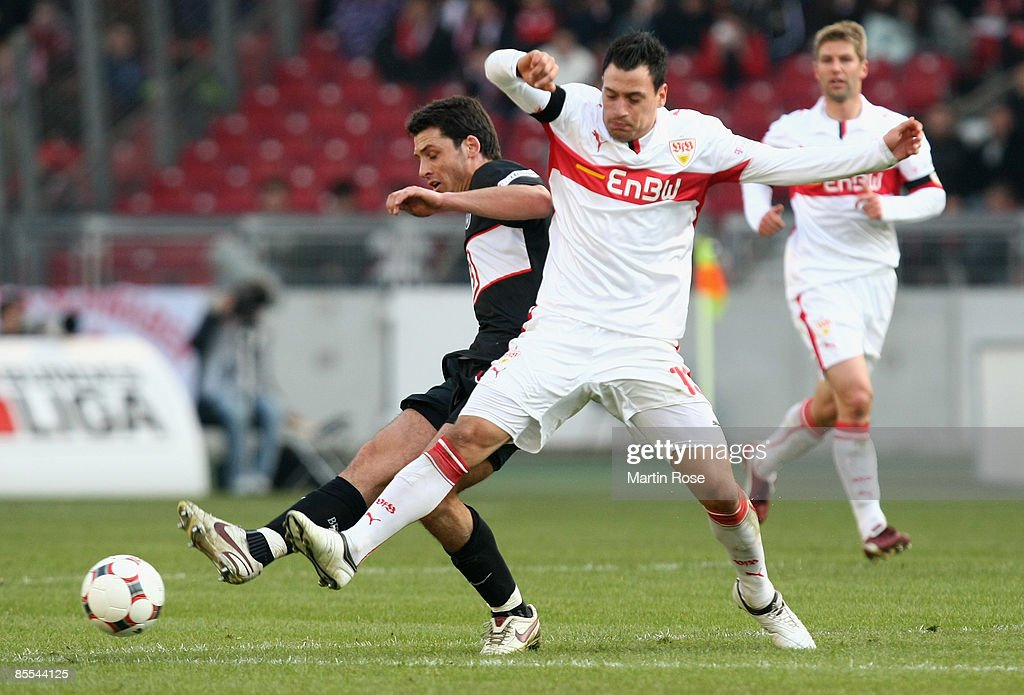 Timo Gebhart (R) of Stuttgart and Gojko Kacar (L) of Berlin battle for the ball during the Bundesliga match between VfB Stuttgart and Hertha BSC Berlin at the Mercedes-Benz Arena on March 21, 2009 in Stuttgart, Germany.