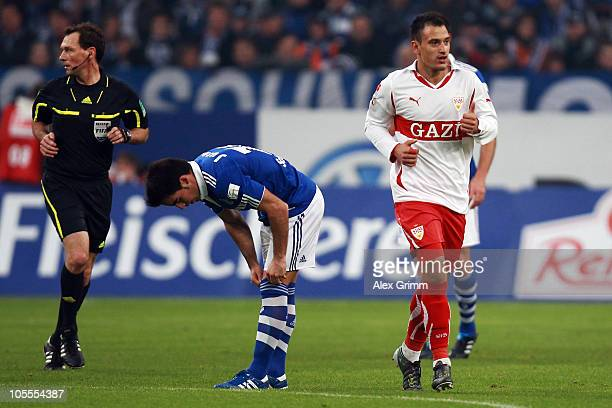 Timo Gebhart of Stuttgart celebrates his team's first goal as he passes Jose Manuel Jurado of Schalke during the Bundesliga match between FC Schalke...