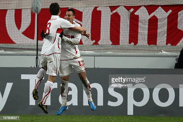 Timo Gebhart of Stuttgart celebrates his team's second goal with team mate Zdravko Kuzmanovic during the UEFA Europa League group H match between VfB...