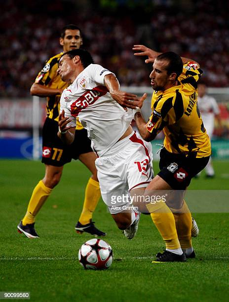 Timo Gebhart of Stuttgart is challenged by Iasmin Latovlevici of Timisoara during the Champions League Qualifier match between VfB Stuttgart and FC...