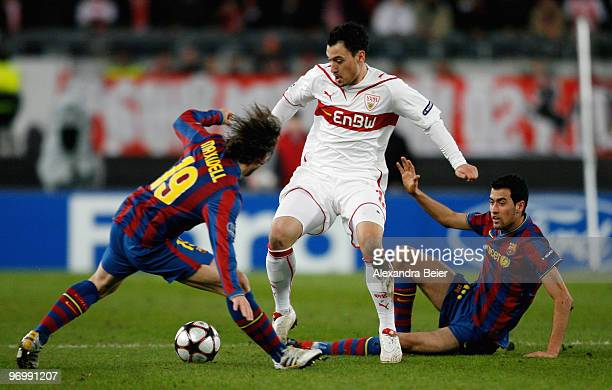 Timo Gebhart of VfB Stuttgart fights for the ball with Sergio Busquets and Maxwell of FC Barcelona during the UEFA Champions League round of sixteen...