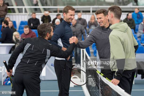 Timo Glock DTM race driver Florian Mayer Patrik Kuehnen tournament director BMW Open and Maximilian Marterer shake hands after the BMW Open Show...