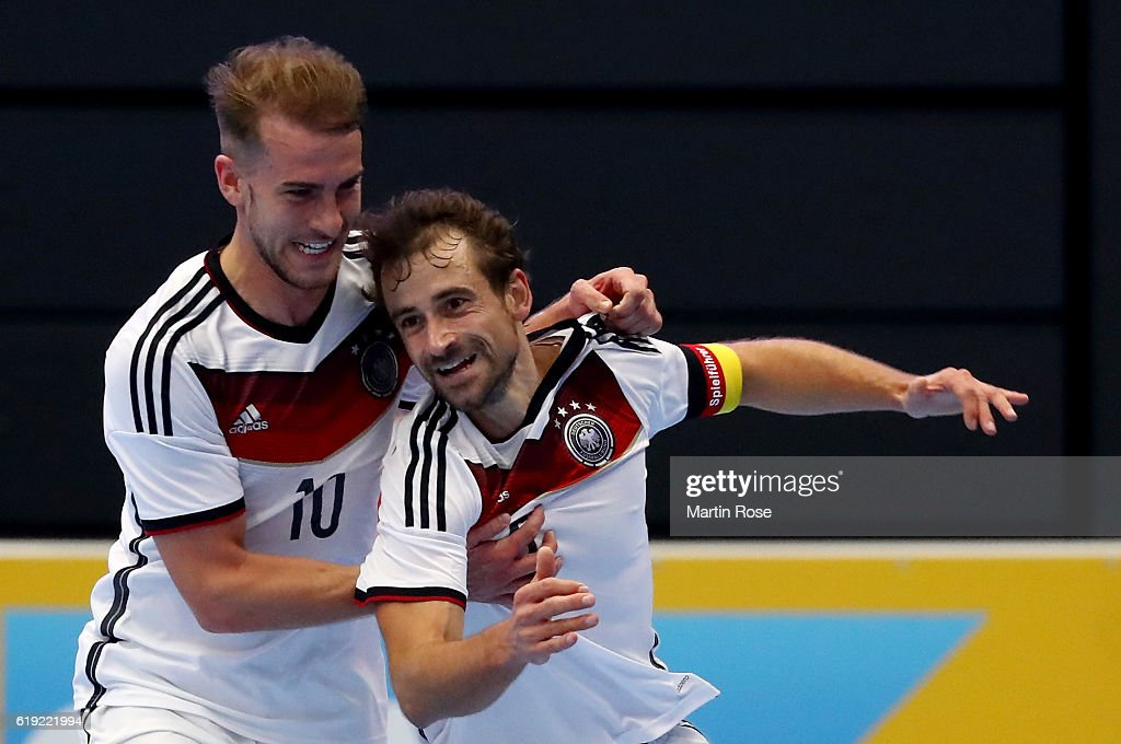 Timo Heinze #6 of Germany celebrates with team mate Michael Meyer after he scores his team's opening goal during the Futsal International Friendly match between Germany and England at Inselparkhalle on October 30, 2016 in Hamburg, Germany.