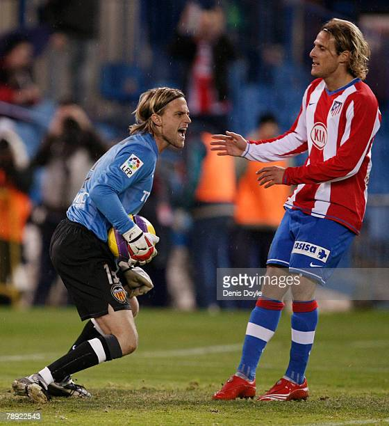 Timo Hildebrand of Valencia catches the ball beside Diego Forlan of Atletico Madrid during the La Liga match between Atletico Madrid and Valencia at...