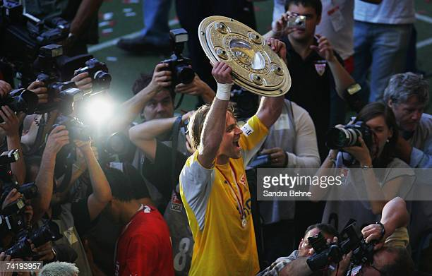 Timo Hildebrand of VfB Stuttgart celebrates with the trophy after winning the German championships after the Bundesliga match against Energie Cottbus...