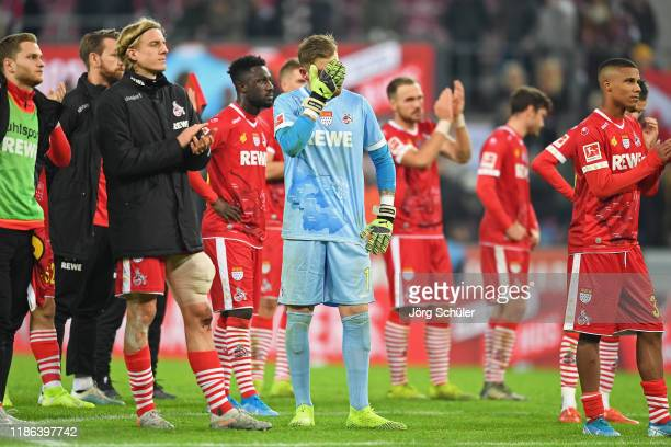 Timo Horn of 1 FC Koeln looks dejected following his team's defeat in the Bundesliga match between 1 FC Koeln and TSG 1899 Hoffenheim at...