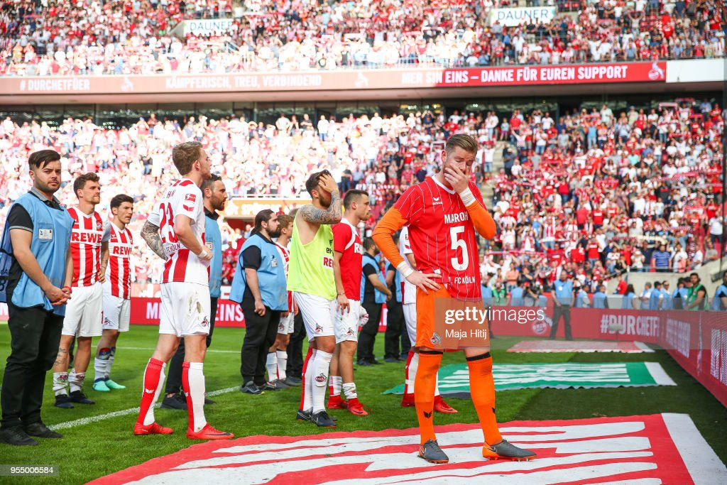 Timo Horn #1 of 1.FC Koeln and players of 1.FC Koeln react after the Bundesliga match between 1. FC Koeln and FC Bayern Muenchen at RheinEnergieStadion on May 5, 2018 in Cologne, Germany.