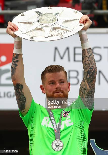 Timo Horn of FC Koeln celebrates with the Second Bundesliga trophy at the end of the Second Bundesliga match between 1. FC Koeln and SSV Jahn...