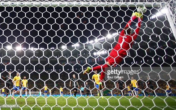 Timo Horn of Germany can't save a free kick from Neymar as Brazil score the first Brazil goal during the Men's Football Final between Brazil and...
