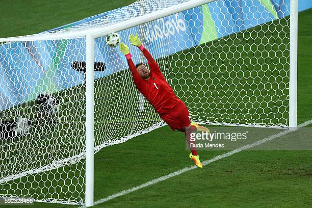 Timo Horn of Germany can't save a free kick from Neymar of Brazil to score the first Brazil goal during the Men's Football Final between Brazil and...