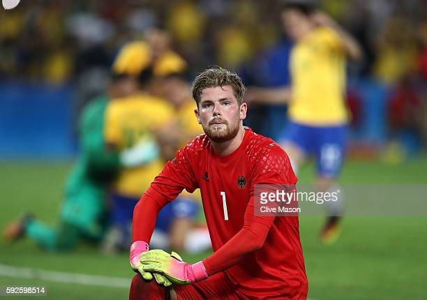 Timo Horn of Germany reacts as Neymar of Brazil scores the winning penalty in the penalty shoot out during the Men's Football Final between Brazil...
