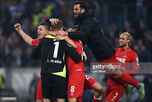 Timo Horn of Koeln celebrates with team mates after winning the DFB Cup second round match between MSV Duisburg and 1. FC Koeln at...