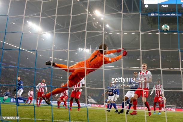 Timo Horn of Koeln saves a ball during the Bundesliga match between FC Schalke 04 and 1 FC Koeln at VeltinsArena on December 2 2017 in Gelsenkirchen...