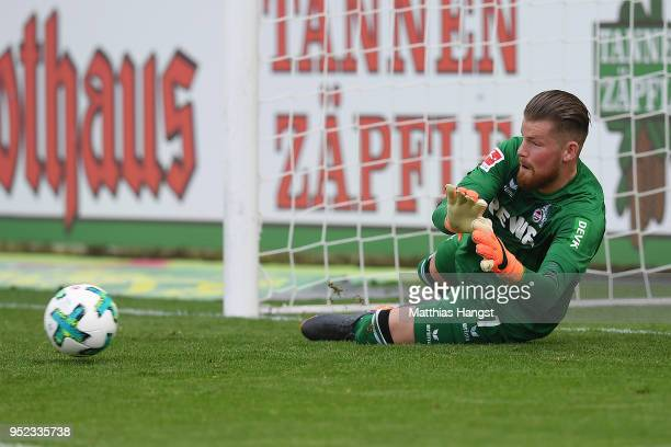 Timo Horn of Koeln saves a penalty by Christian Guenter of Freiburg during the Bundesliga match between Sport-Club Freiburg and 1. FC Koeln at...