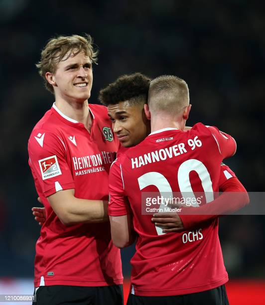 Timo Huebers, Linton Maina and Philipp Ochs of Hannover 96 celebrate after scoring during the Second Bundesliga match between Hannover 96 and...