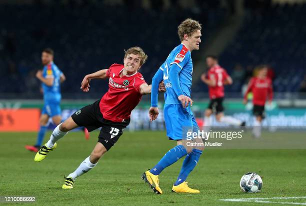 Timo Huebers of Hannover 96 and Johannes van den Bergh of Holstein Kiel battle for the ball during the Second Bundesliga match between Hannover 96...