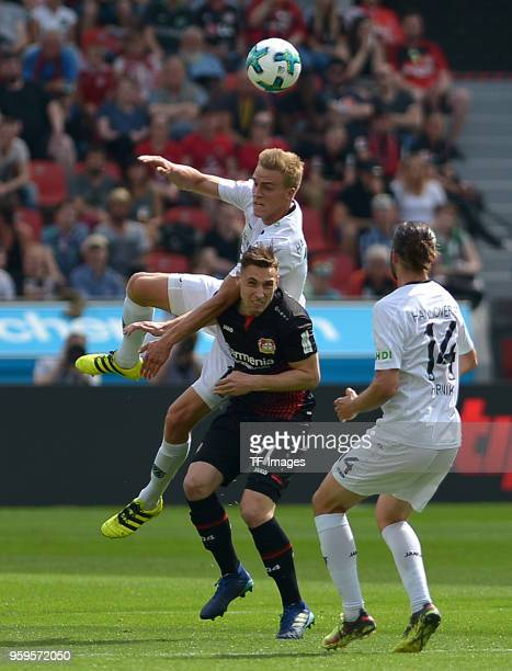 Timo Huebers of Hannover Dominik Kohr of Leverkusen and Martin Harnik of Hannover battle for the ball during the Bundesliga match between Bayer 04...