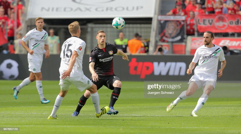 Timo Huebers of Hannover (L) tackles Dominik Kohr of Leverkusen during the Bundesliga match between Bayer 04 Leverkusen and Hannover 96 at BayArena on May 12, 2018 in Leverkusen, Germany.