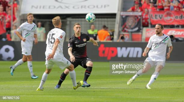 Timo Huebers of Hannover tackles Dominik Kohr of Leverkusen during the Bundesliga match between Bayer 04 Leverkusen and Hannover 96 at BayArena on...