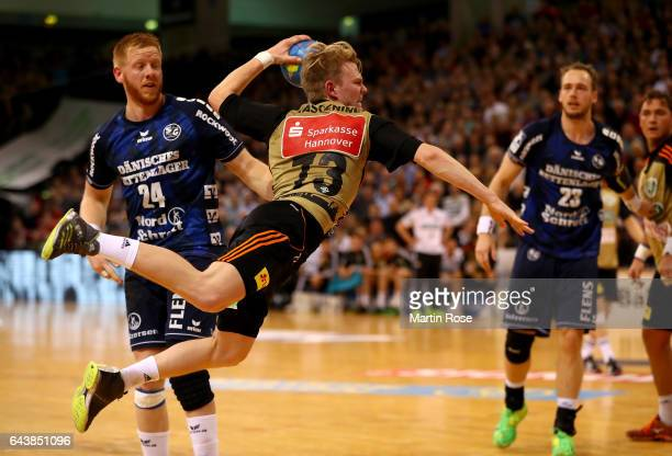 Timo Kastening of HannoverBurgdorf throws at goal during the DKB HBL Bundesliga match between SG FlensburgHandewitt and TSV HannoverBurgdorf on...
