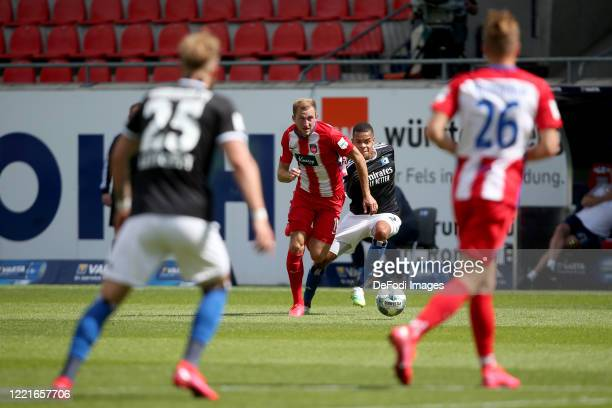 Timo Letschert of Hamburger SV, Jonas Foehrenbah of 1.FC Heidenheim 1846, Jan Gyamerah of Hamburger SV and David Otto of 1.FC Heidenheim 1846 battle...