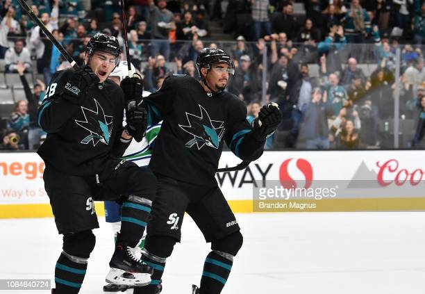 Timo Meier and Evander Kane of the San Jose Sharks celebrate scoring a goal against the Vancouver Canucks at SAP Center on November 23 2018 in San...