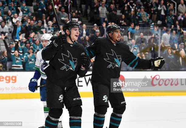 Timo Meier and Evander Kane of the San Jose Sharks celebrate scoring a goal against the Vancouver Canucks at SAP Center on November 23 2018 in San...