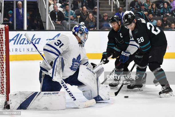 Timo Meier and Joe Pavelski of the San Jose Sharks drive the net on Frederik Andersen of the Toronto Maple Leafs at SAP Center on November 15, 2018...