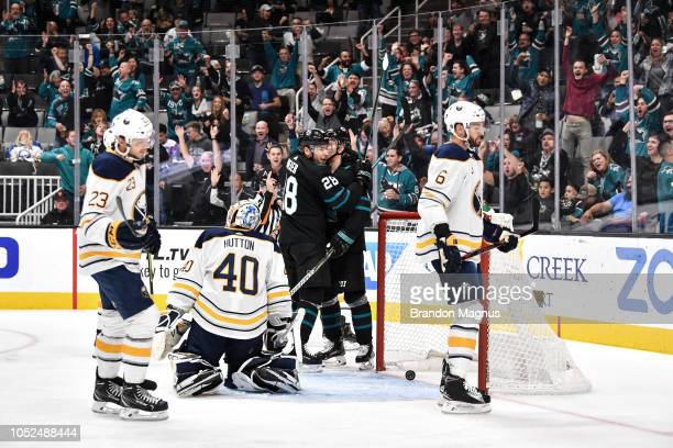 Timo Meier and Joonas Donskoi of the San Jose Sharks celebrate scoring a goal against the Buffalo Sabres at SAP Center on October 18 2018 in San Jose...