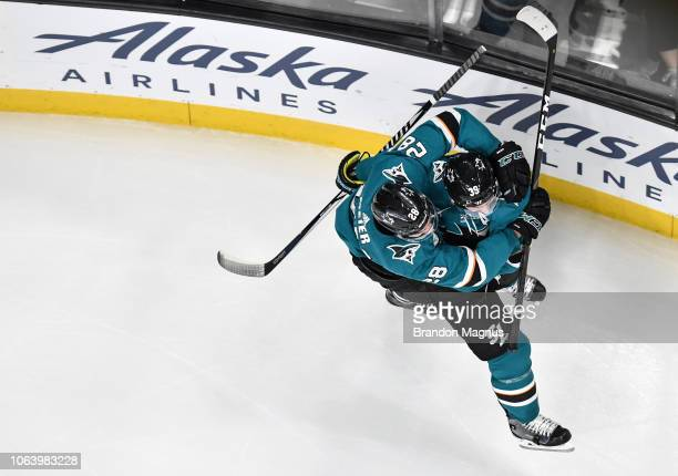 Timo Meier and Logan Couture of the San Jose Sharks celebrate scoring a goal against the Edmonton Oilers at SAP Center on November 20 2018 in San...