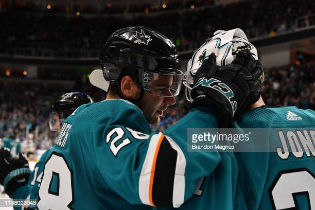 Timo Meier and Martin Jones of the San Jose Sharks celebrate the win against the Vegas Golden Knights in Game Five of the Western Conference First...