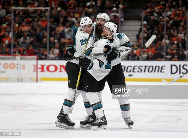 Timo Meier Brent Burns and Paul Martin of the San Jose Sharks celebrate Burns' goal in the second period against the Anaheim Ducks in Game One of the...