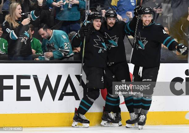 Timo Meier Erik Karlsson and Brenden Dillon of the San Jose Sharks celebrate a goal against the Dallas Stars at SAP Center on December 13 2018 in San...