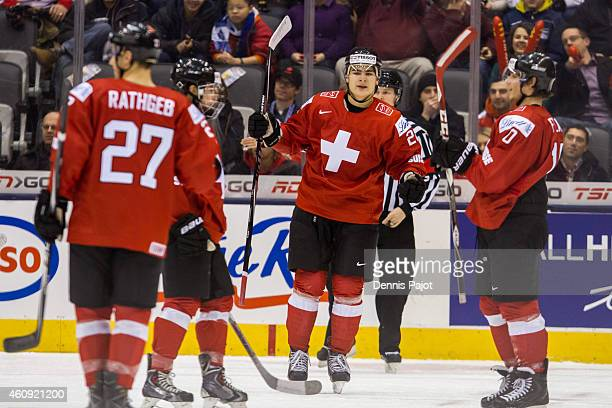 Timo Meier of Switzerland celebrates his goal against Denmark during the 2015 IIHF World Junior Championship on December 30 2014 at the Air Canada...